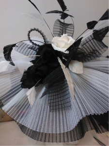 Beautiful bespoke black and white hat with delicate details.