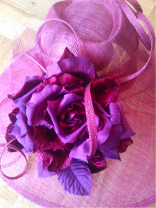 Beautiful bespoke hat, full of summer colours with a gorgeous statement flower!