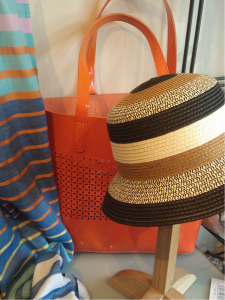 Orange bag WAS £40, NOW £20,  Hat WAS £27, NOW £22, Scarf WAS £29, NOW £15.