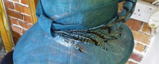 This beautiful teal sinamay hat with Lady Amhusrt pheasant feather  Was £295 Now £95.  Visit us in our store in Otford, near Sevenoaks to see the last of the sale..Hurry ends soon!