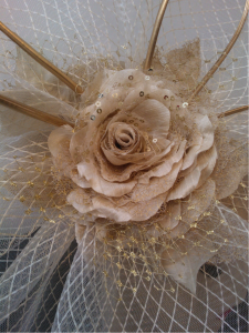 A beautiful flower statement handmade out of velvets and silks, and sprinkled with bling!