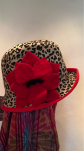 Leopard print hat with a gorgeous statement red flower.